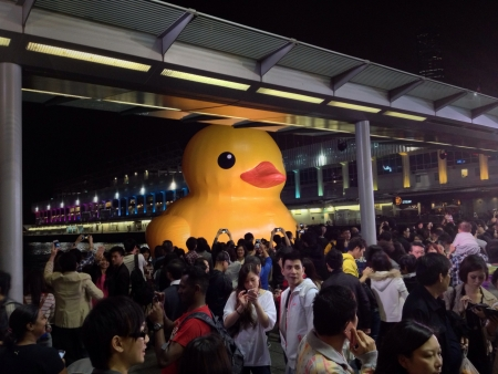 Crowd of Hong Kong citizens admire the 54 foot yellow rubber duck by Florentijn Hofman