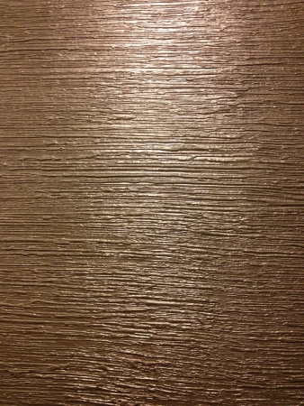 grooved: Textured paint on a wall