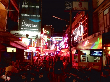 Night scene of one of the alleys leading into Soi Cowboy, Thailand   Stock Photo