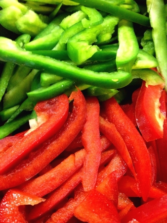 Red and Green Capsicum Slices Stock Photo