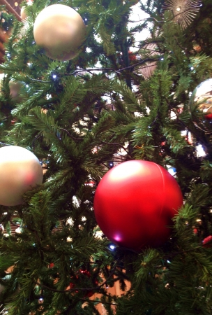 Christmas baubles hanging on a plastic tree