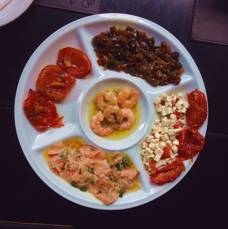 A Brazilian appetizer consisting of shrimp, olives, fish and dried tomatoes in So Paulo  Stock Photo