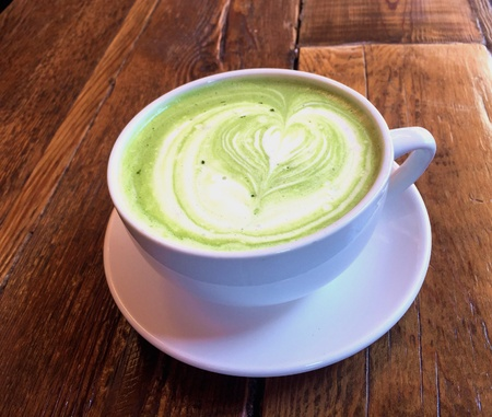 Green tea latte with coffee art