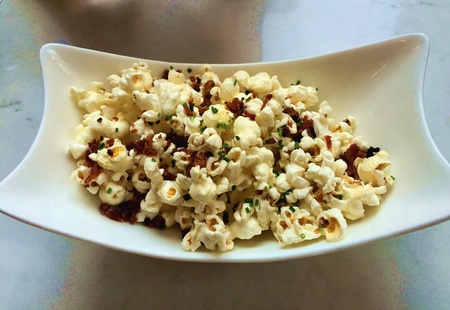 bacon bits: Beer food: Popcorn with Bacon bits Stock Photo