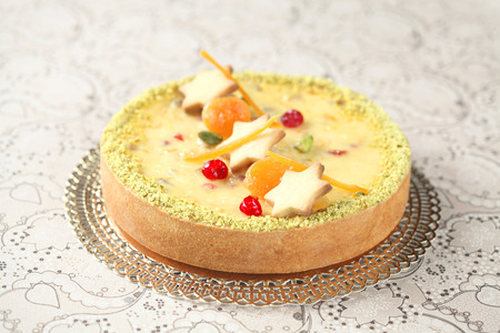 crystallized: White Chocolate Cheesecake with biscuit stars, pistachios and crystallized fruit
