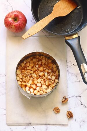 Step by step process of making a modern Caramel Apple Mousse Cake