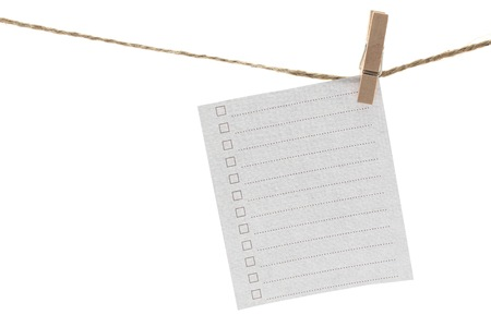 pinched: Hanging Notepad on White Background Stock Photo