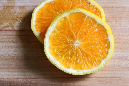 sliced orange: Sliced Orange On Wooden Cutting Board Stock Photo