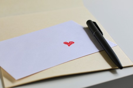 love confession: Red Love Heart On White Envelope