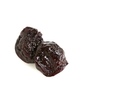 prune: Pitted Prune on White Background