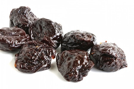 pitted: Pitted Prune on White Background