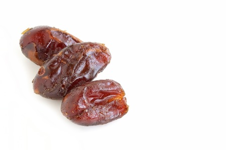 pitted: Dried Pitted Dates on White Background