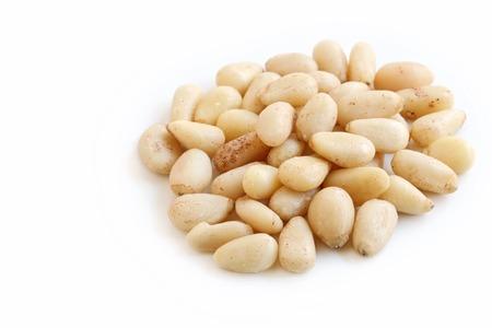 pinoli: Pine Nuts on White Background