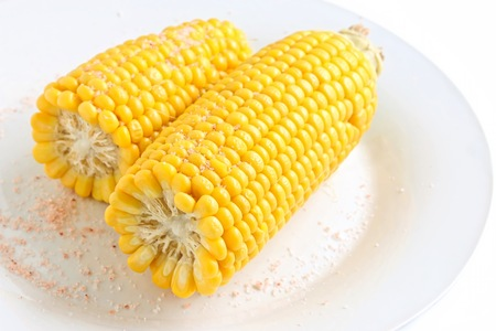 Freshly Cooked Sweet Corn on White Plate