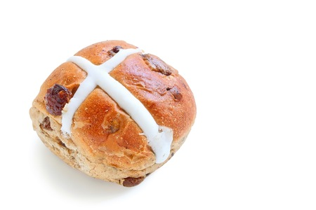 Freshly Baked Hot Cross Bun on White Background
