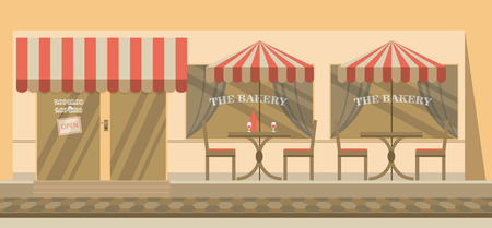 sidewalk cafe: The facade of the cafe with umbrellas, chairs, tables