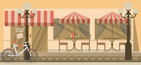 The facade of the cafe with umbrellas, chairs, tables