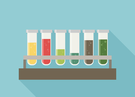 bubbling: five multicolor test tubes with green, blue, orange, yellow and red bubbling sparkling liquid in rack.