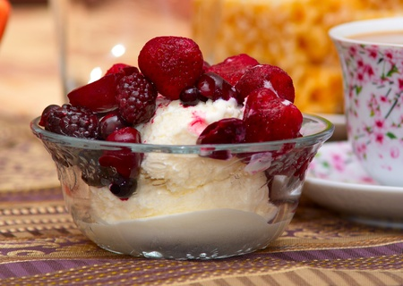 ice cream in a glass bowl with frozen berries photo