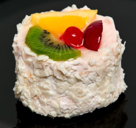 tutti frutti cake, with lemon, kiwi, cherries, plums photo
