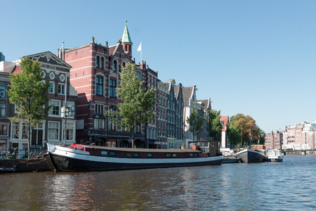 amstel: Houses and barges on the river Amstel in Amsterdam