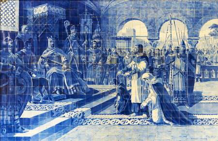 Porto, Portugal - October 13, 2016: Azulejo panel in the Sao Bento railway station, painted by Jorge Colaco. Egas Moniz to voluntarily turned himself in to the king of Castile and Leon Alfonso VII Editorial