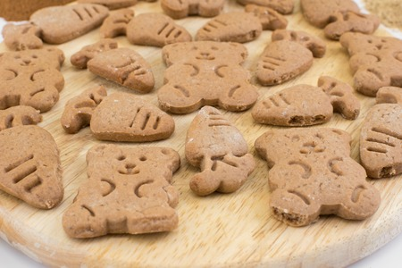 snaps: flavoured figure ginger snaps on a wooden board