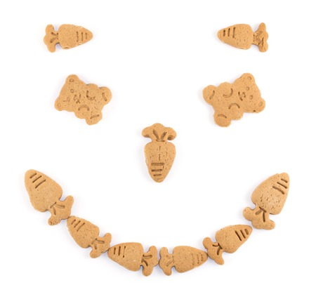 snaps: smile figure made of ginger snaps on white background