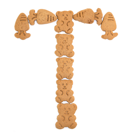 sweet sugar snap: isolated T letter of english alphabet made by cookies