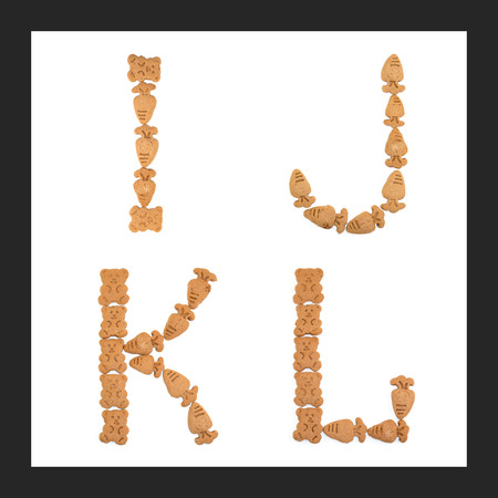 english letters: isolated I, J, K, L letters of english alphabet made by cookies