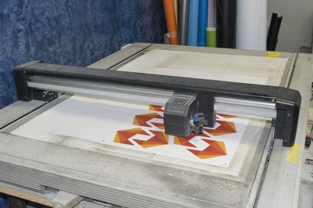 flatbed cutting plotter in a working process Stock Photo
