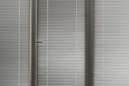 window shade: grey horizontal jalousie in the office window Stock Photo