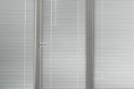 jalousie: grey horizontal jalousie in the office window Stock Photo