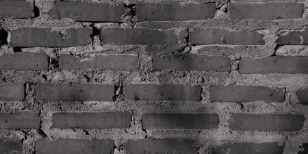 Gray brick wall background banner.