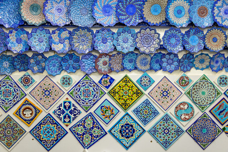 isfahan: glazed tiles and iranian souvenirs in the Bazaar of Isfahan Stock Photo