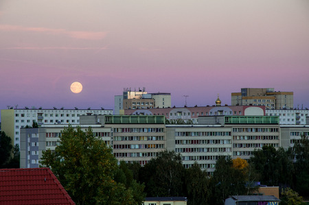 Leipzig at dawn with rising moon Stock Photo