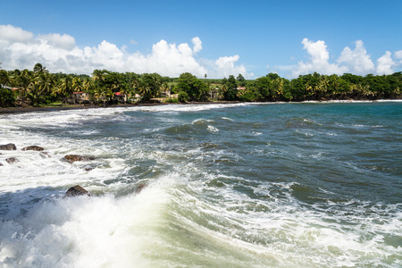 foaming waves in a bay of Guadeloupe