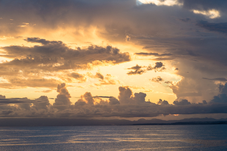 colorful sunset behind a wall of clouds, Guadeloupe