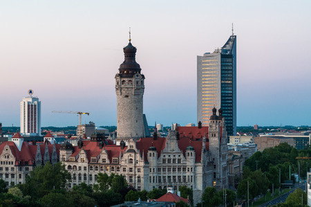 Skyline of Leipzig with towm hall after sunset, Germany