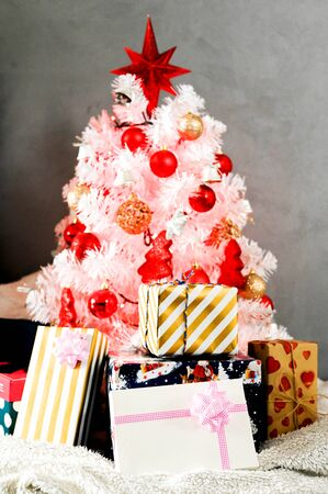 White Christmas tree, with red decoration and christmas light