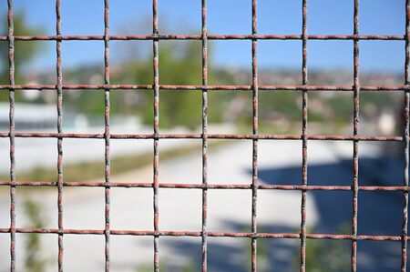 Metal fence with a square pattern for site protection