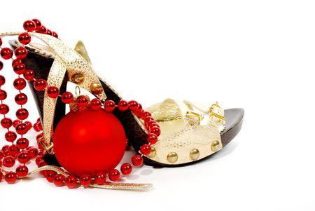 Christmas decoration: shoes, beads and Christmas balls photo