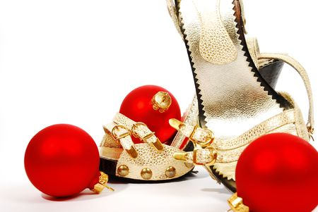 shoes and christmas balls on a white background photo