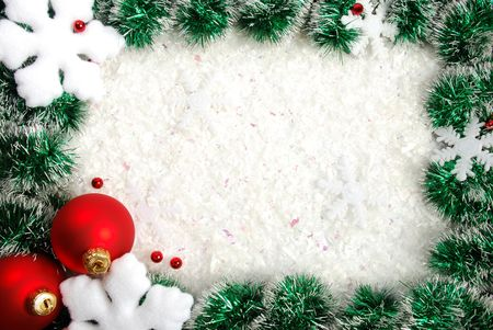 Christmas frame from a garland, snowflakes and balls photo