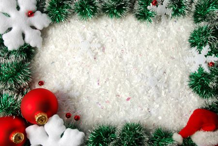 Christmas frame from a garland, snowflakes, balls and hat photo