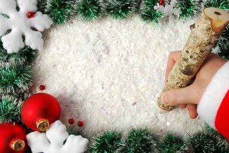 Christmas frame with snowflakes, balls and writing hand Standard-Bild
