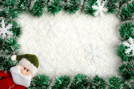 Christmas frame from a garland, snowflakes and Santa  photo