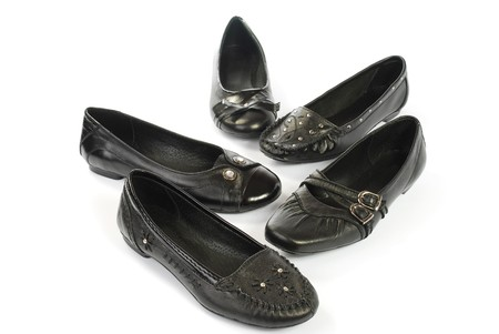 black womanish shoes on a white background