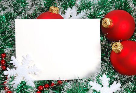 Blank christmas greeting card and garland, snowflakes, balls