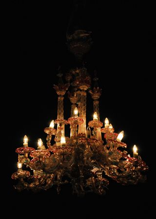 elegant crystal chandelier on black background  photo